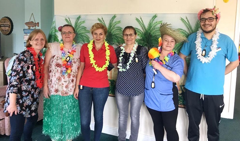 Staff dressed up for tropical fun day at Cornford House
